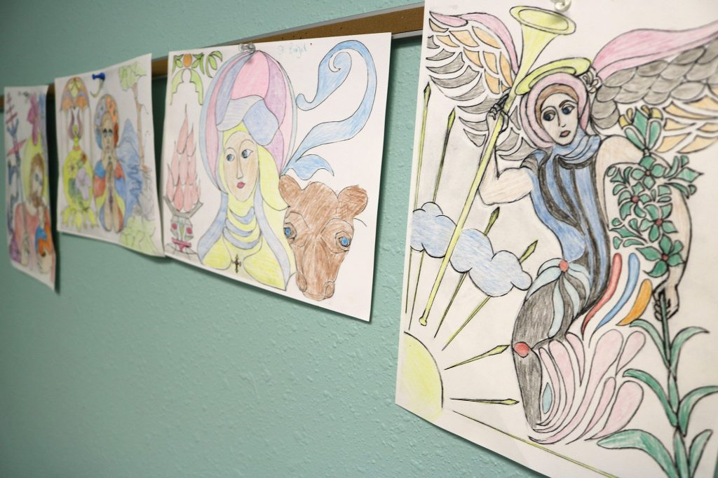 An Angel and other children's drawings hanging on the wall of the Sunday school at Sacred Heart Catholic Church in Conway MO
